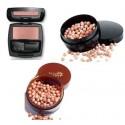 Colorete y perlas bronceadoras